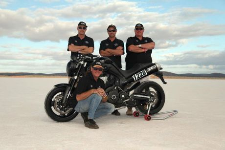 Tony Brearley (front), at Lake Gairdner where he has broken two Australian records on a 2000cc production bike during Speedweek 2015. Behind him is his crew, from left, Barrie Scott, Kristian Sudiro and Anton Brinkmann.