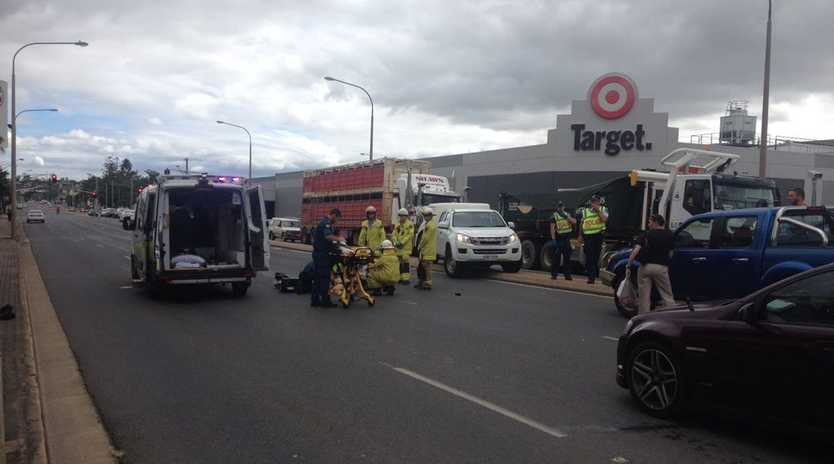 MAN HIT: Emergency services work to treat a man hit by a car.