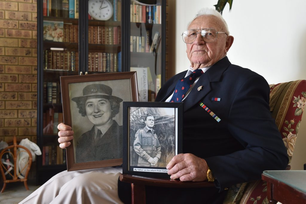 Alf Dennis with a photo of his wife Mary and his dad Alf who was at Gallipoli.