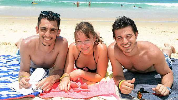 BACKPACKERS: Enjoying the holiday season at Rainbow Beach are backpackers off to Fraser Island. Pictured (from left) is Pedro Couri from Brazil, Jenny Meinhardt from Germany and Rafael Coultre from Brazil.