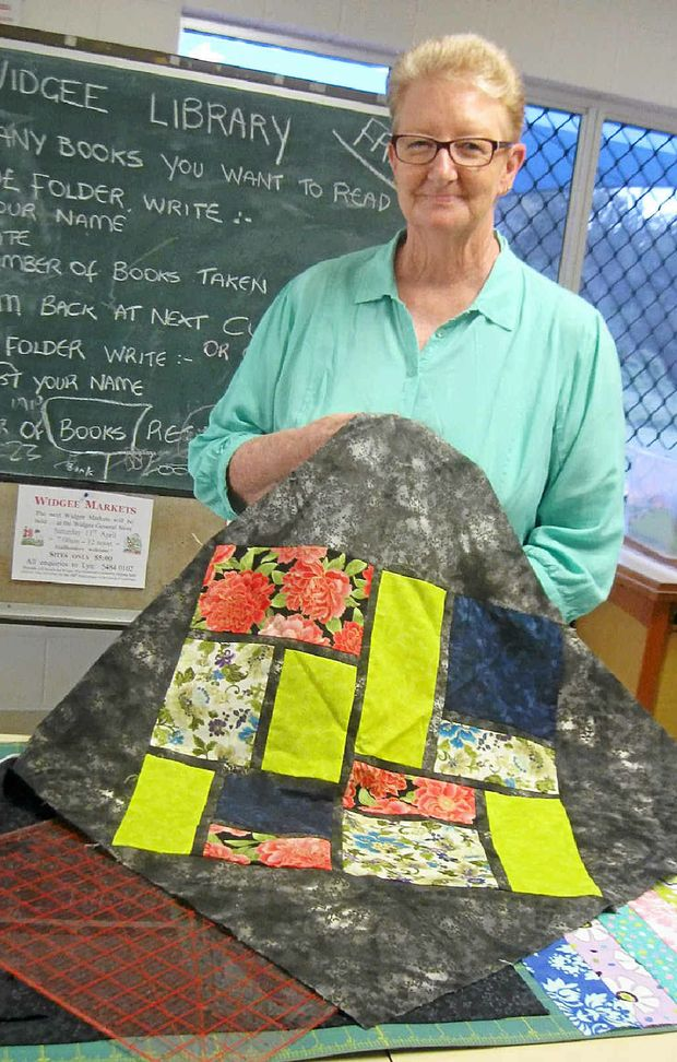 CLEVER HANDS: Margaret Fittler displaying the centrepiece for her latest quilt at Pure Patchwork.