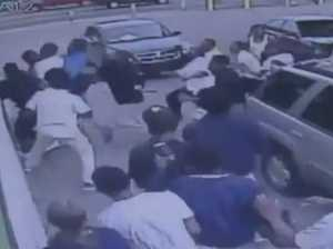 Teenagers swarm on man at gas station