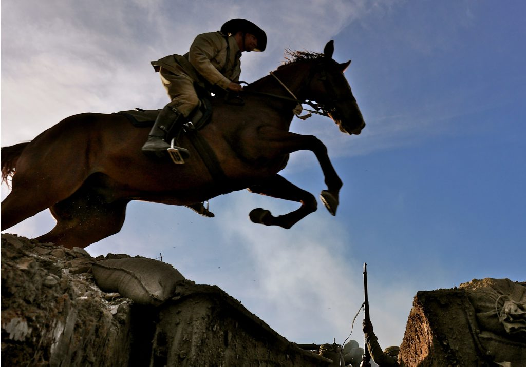 Midnight jumps the Ottoman trench in a dramatic recreation from the TV documentary Australia's Great War Horse.