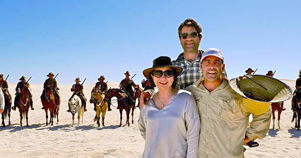 Producer Marian Bartsch, director Russell Vines and special effects supervisor Bruce Flint pictured on the set of Australia's Great War Horse, filming a charge scene at Lancelin Sand Dunes in WA.