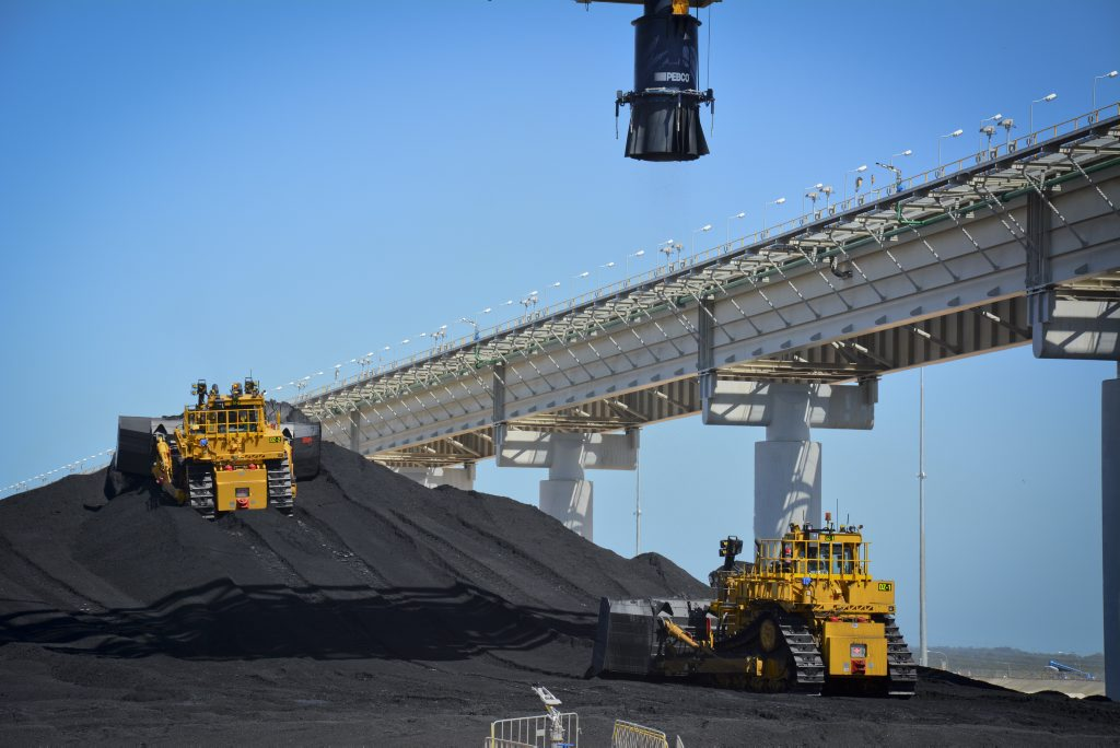 A week after the first load of coal arrives at the Wiggins Island Coal Export Terminal, dozers and trucks begin to move the coal to bed down the stockyard.
