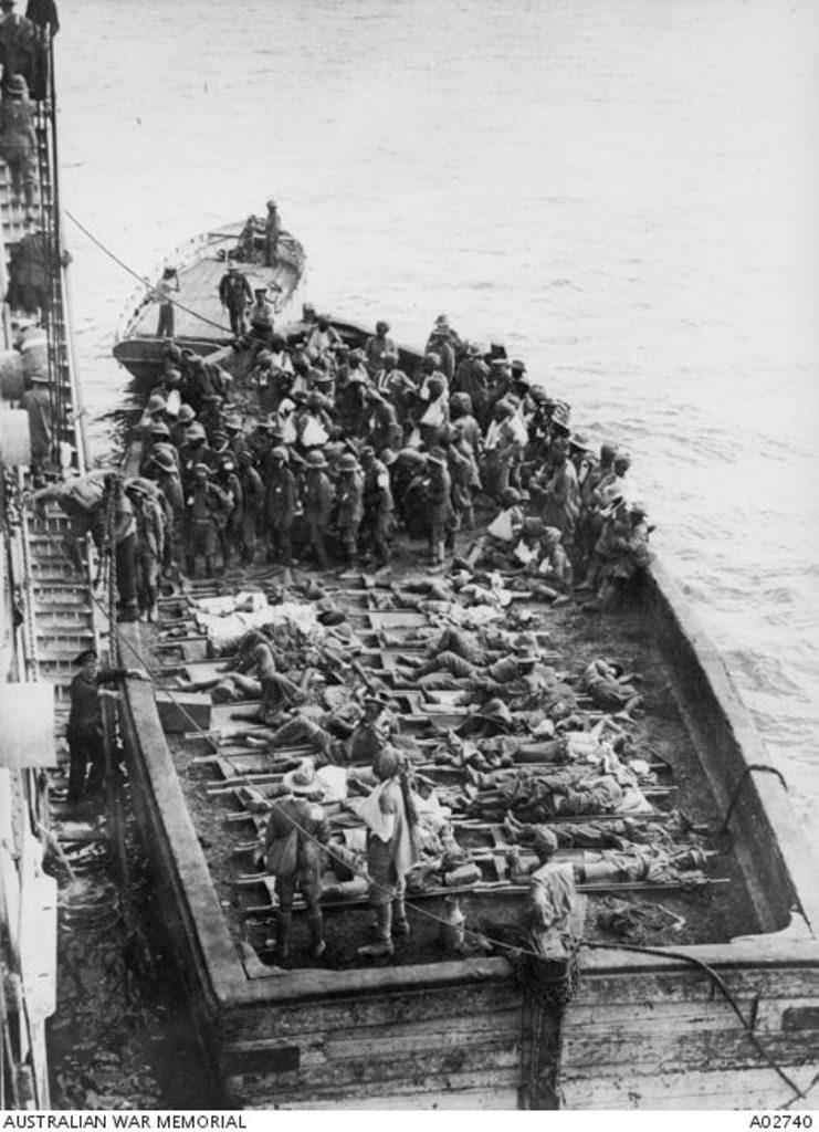 A barge transports wounded soldiers from Anzac Cove to the hospital ship Gascon. Courtesy of Australian War Memorial A02740