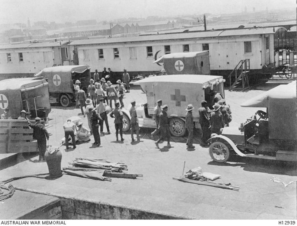 Army patients from Gallipoli being transferred from hospital ship Gascon to a hospital train in Alexandria, Egypt, for movement to Cairo in 1915.