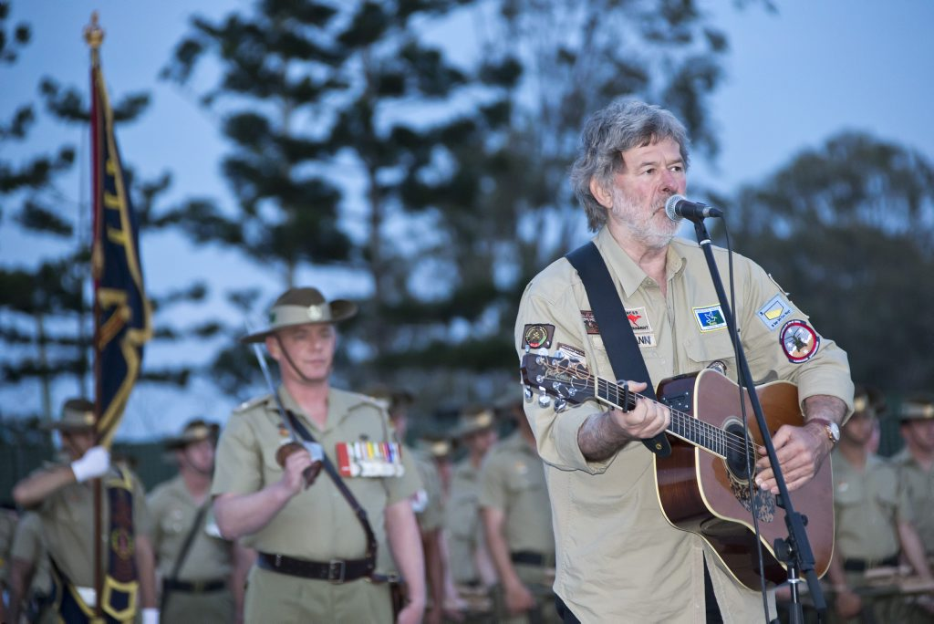 Australian entertainer John Schumann performs an emotional rendition of I was only 19' during festivities marking the 41st birthday of the Australian Army 8th/9th Battalion, Royal Australian Regiment, at Gallipoli Barracks in Brisbane on 31 October, 2014.