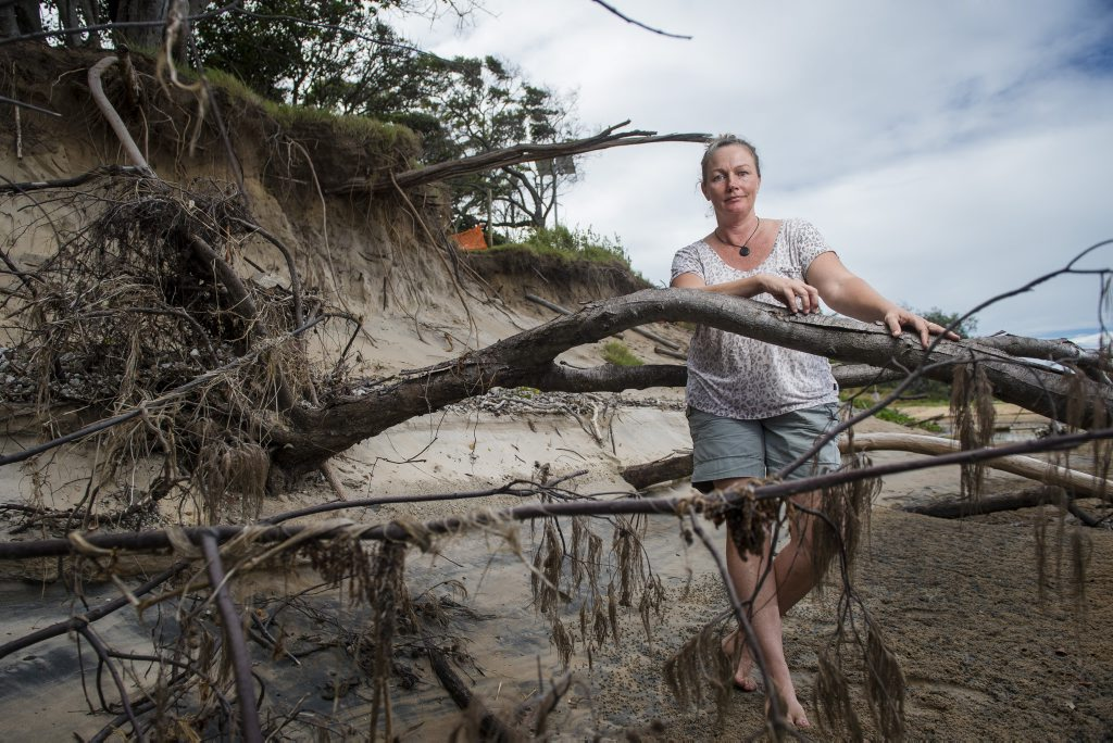 WASHED AWAY: Wild Cattle Creek has been eroded, halting the access to the beach below. Local resident Kahn Bailey is ashamed at the slow progress council is taking to address the problem.