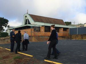 Police outside the Toowoomba mosque which was badly damaged by fire overnight.