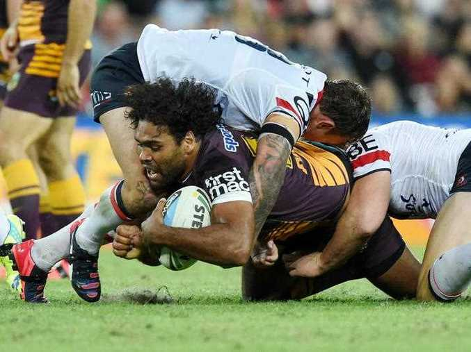 Sam Thaiday of the Brisbane Broncos is tackled to the ground during their Round 6 game against the Sydney Roosters at Suncorp Stadium in Brisbane, Friday, April 10, 2015.