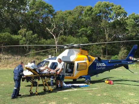 A Scottish man was flown to Hervey Bay Hospital with a broken leg and suspected broken hip after falling from a tour bus on Fraser Island.