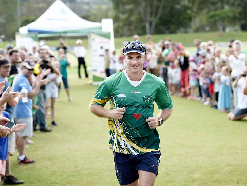FOND FAREWELL: David Alley leaves Oakes Oval in Lismore on his Race Around Australia to raise funds for depression.