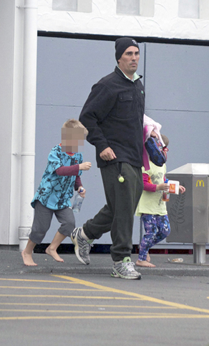Mathew Sinclair leaves McDonalds in Taradale with his children.
