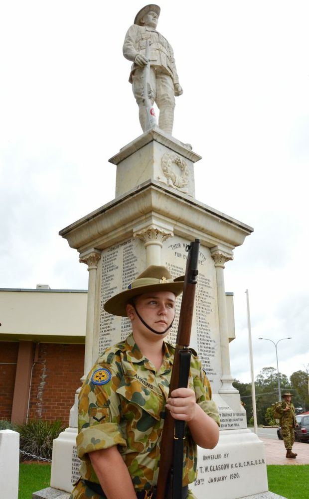 LEST WE FORGET: L Cpl Julie Ahrens at the Nanango War Memorial where the statue is finally being restored.