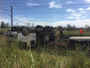 Truck rolled over onto train tracks