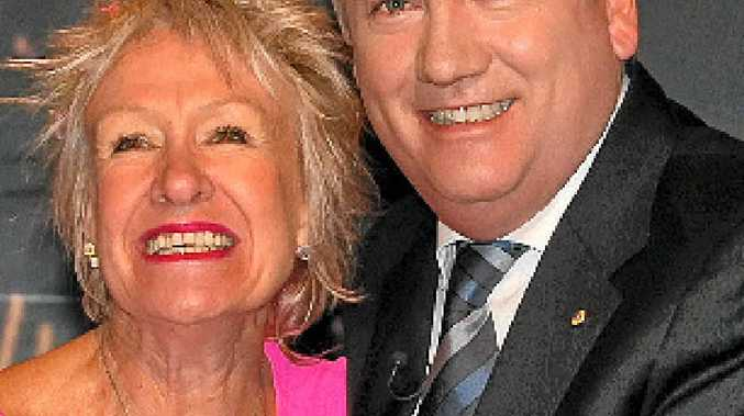 PINK LADY: Gympie midwife Melissa Orrman with Millionaire Hot Seat host Eddie McGuire.