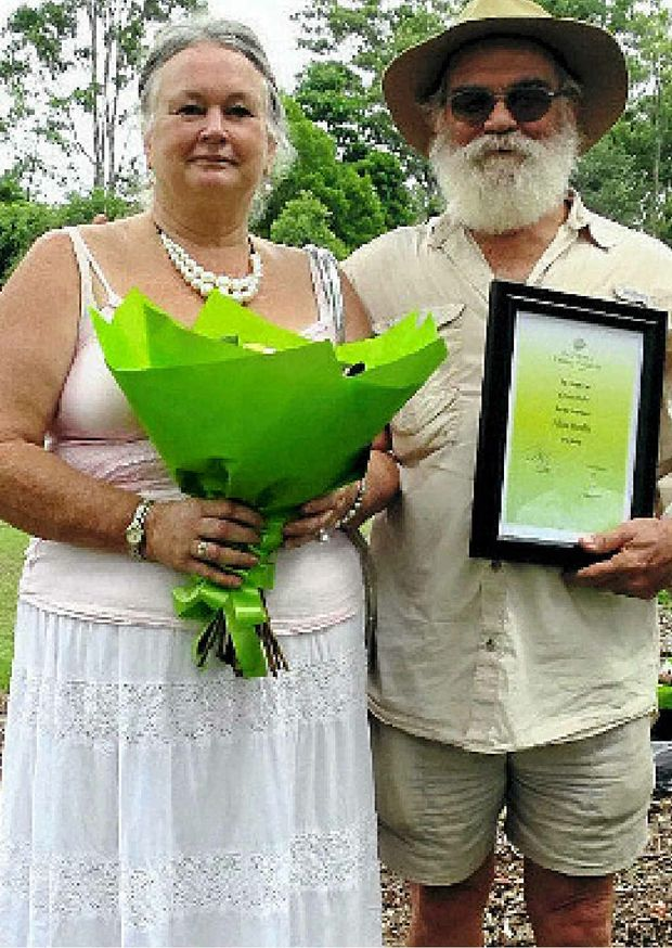 RECOGNITION: Marion and Ernie Rider with the Fellowship Citation. ABOVE: The centre piece of the Sherwood Arboretum is this avenue of north Queensland kauri pines planted in 1925.