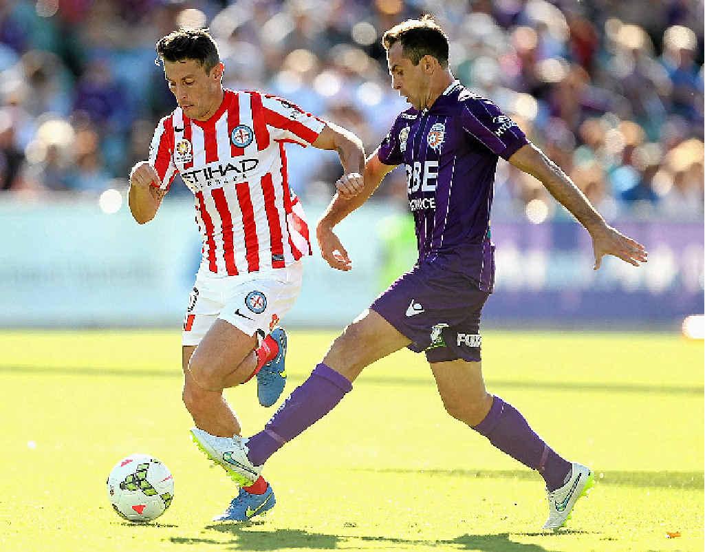 BATTLE ON: Robert Koren (left) fights for possession with Perth Glory's Richard Garcia.