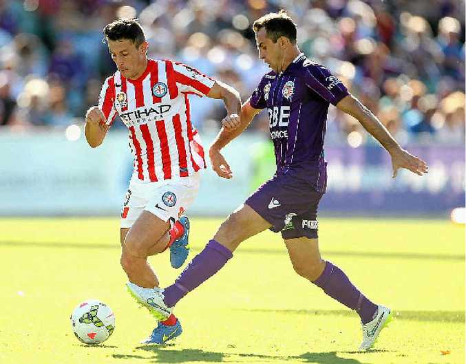 BATTLE ON: Robert Koren (left) fights for possession with Perth Glory's Richard Garcia.