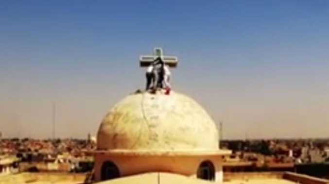 The new video showed Isis militants tearing crosses from Christian churches