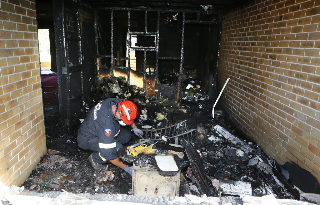 (POOL).Fire investigator inside the fire destroyed Toowoomba Mosque. Pic POLICE MEDIA (POOL)