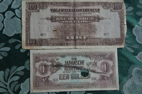 Japanese currency printed during World War 2 as occupation money. The currency was reportedly destroyed when the war came to an end. Max believes the note (pictured bottom) boasts a bullet hole. Photo Kate Darvall/ South Burnett Times