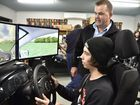 DRIVING SKILL: New driving simulators launched at the PCYC which will help young drivers. Lehi Watson tests his driving skills with Mich Hughes, branch manager at PCYC Dalby. Photo Bev Lacey / The Chronicle