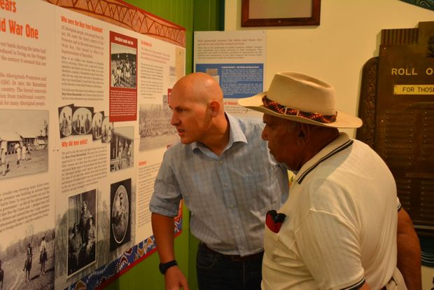 BOYS REMEMBERED: Indigenous Affairs Minister Curtis Pitt and George Couchy inspect the exhibit.