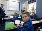 Toowoomba Grammar School Year 7 student Jeremy Bazley enjoys working with his iPad.