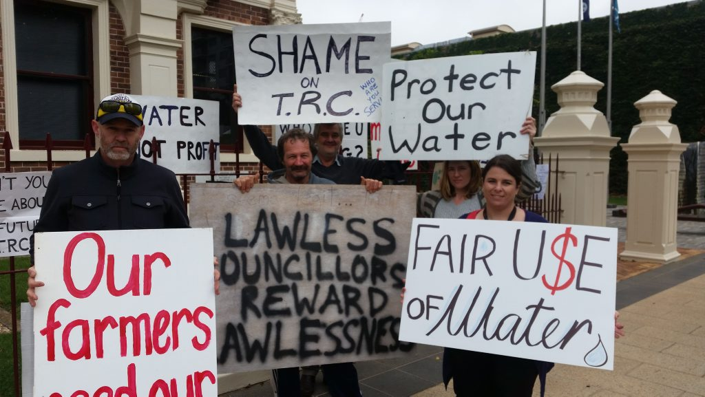 Ian Angow, Rob Cole, Paul King, Elizabeth Ure and Fiona Gray protest outside City Hall ahead of Toowoomba Regional Council's decision on a water bore at Ravensbourne.