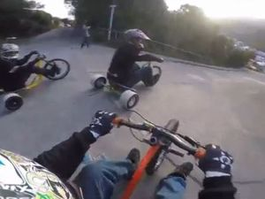 VIDEO: Daredevils ride trikes down world's steepest street