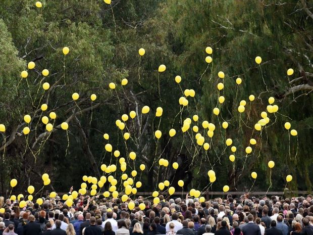 Mourners release balloons during the funeral for murdered Leeton school teacher Stephanie Scott in Eugowra, NSW, Wednesday, April 22, 2015. The 26-year-old was allegedly murdered on Easter Sunday by a cleaner at Leeton High School where she taught English and Drama. (AAP Image/Mick Tsikas)