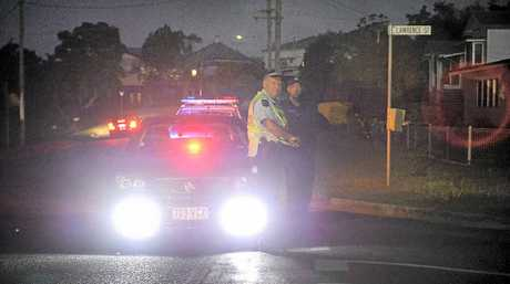 ON GUARD: A police barrier kept civilians away from the potentially lethal action in Lawrence St.