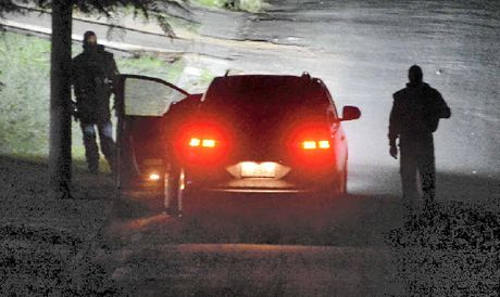 AT THE SCENE: Police approach the siege danger zone on Tuesday night.