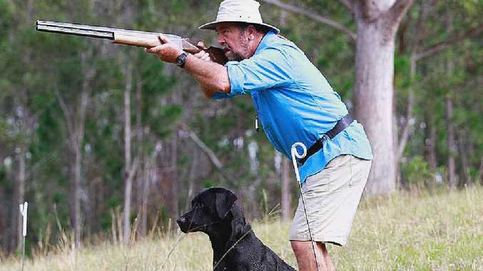 ON THE HUNT: Bryan Pritchard with his dog Gunner.
