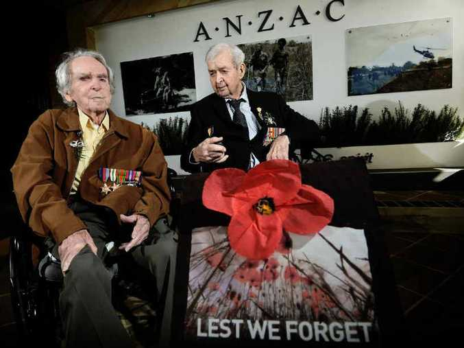 PAYING RESPECTS: Second World War veterans Lloyd Jones and Tom Smith attend the 2015 Anzac commemoration service at the grounds of Fromelles Manor.