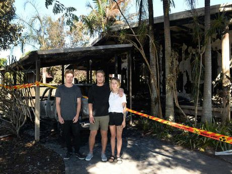 LUCKY TO BE ALIVE: Ryan Walsh, Andrew Brooker and Naomi Tatum. In the early hours of Tuesday morning they escaped the fire (inset) claiming their rented house in Blackbutt Pl, Byron Bay.