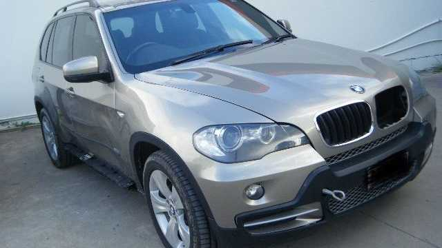 This BMW X5 is a write off after it became bogged on Fraser Island and tide washed over it.