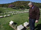 Yeppoon high school teacher Peter Hayes oversees the grave of his great uncle Monaghan Raymond Hayes in Shrapnel Valley Cemetery at Gallipoli.