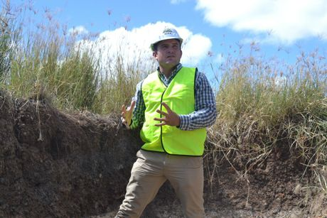 University of Southern Queensland scientist Dr John Bennett shows the cross-section of a parcel of land that was rehabilitated six years ago. Photo Jim Campbell / Chinchilla News