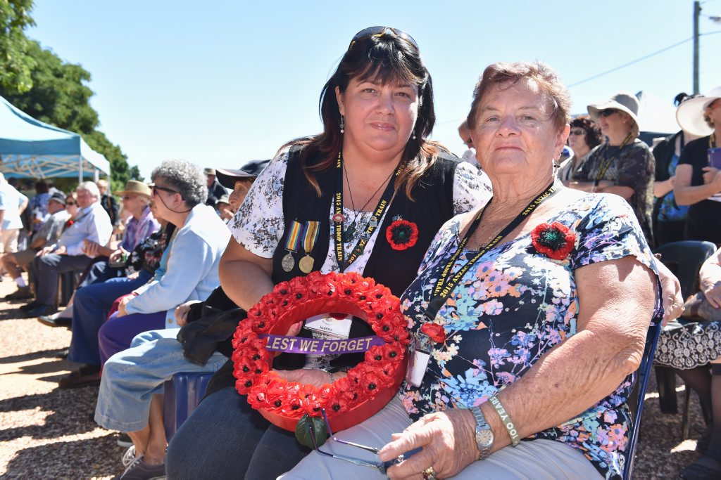 2015 Anzac Troop Train Re-Enactment - Longreach to Emerald. (R) Rose Hawkins and Joanne Connop lay a wreath at Alpha in memory of Pte Reginald Hawkins who enlisted at Jericho. Photo: Alistair Brightman / Fraser Coast Chronicle