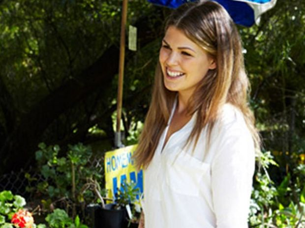 Belle Gibson with her Whole Pantry book, which was pulled from shelves after it was revealed the blogger had never suffered cancer.