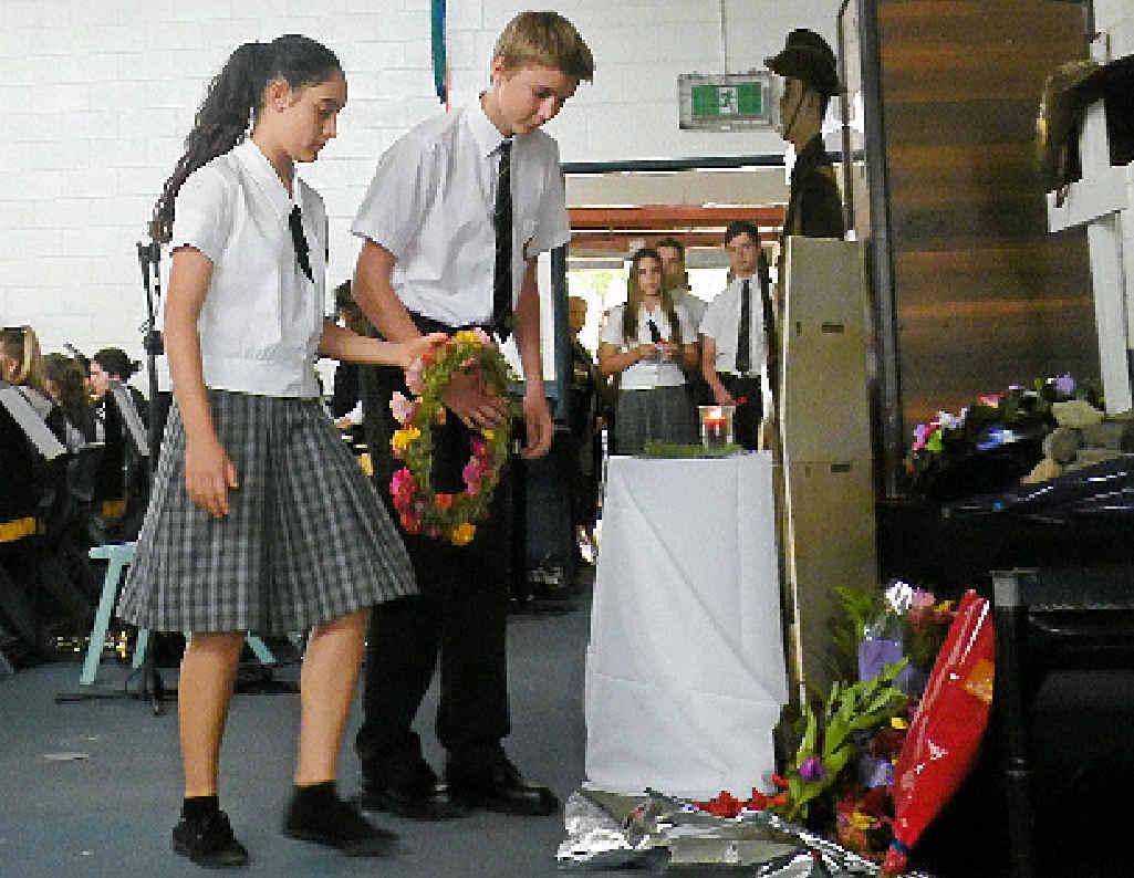 HONOUR: Sarea Taylor and Hamish Rookyard lay a wreath at James Nash State School on Thursday.