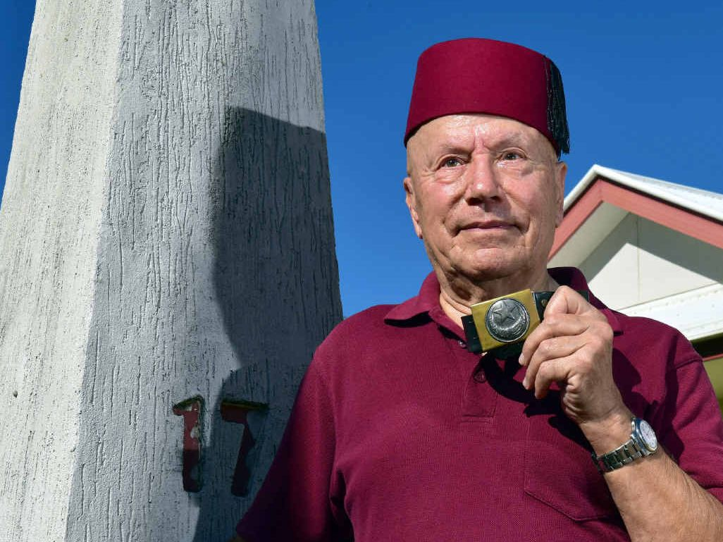 POST NO ILLS: Oz Ertok with his obelisk-style letterbox and his grandfather's belt buckle.