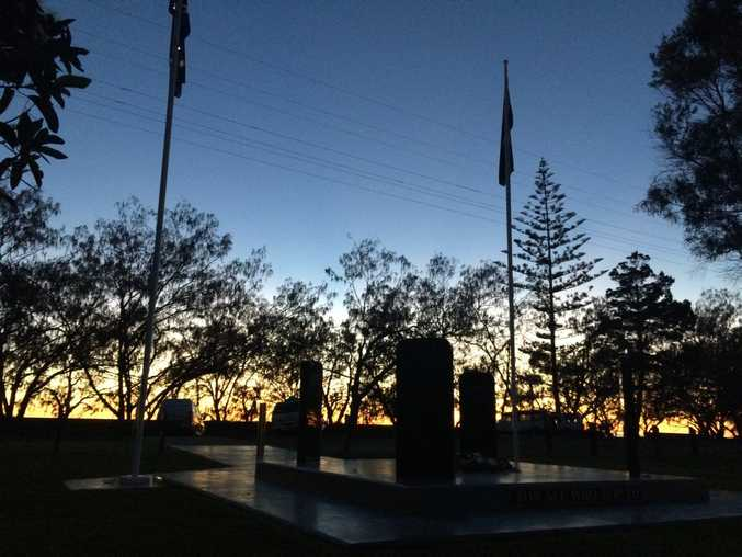 The new memorial stands proud as the sun rises over the Pacific Ocean at Woodgate.