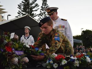 Surf rolls in at packed Kings Beach Anzac Day service