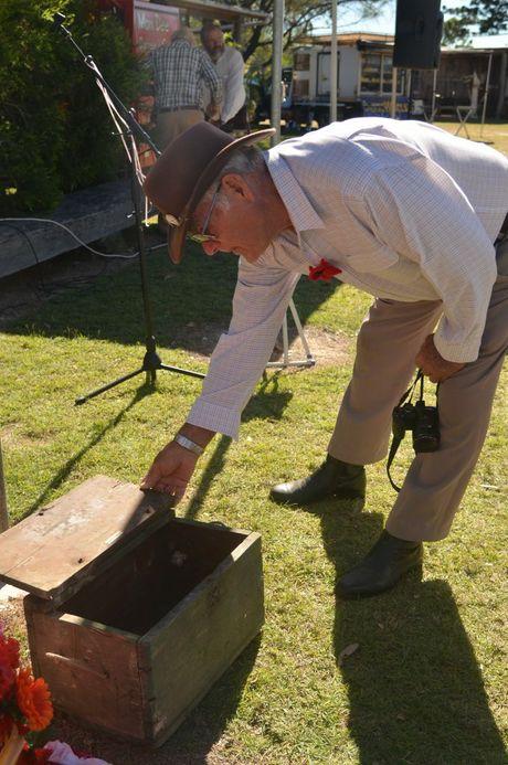 WAR RELIC: Jim Ditton examines his treasured footlocker from the First World War. Photo Brandon Livesay/ South Burnett Times