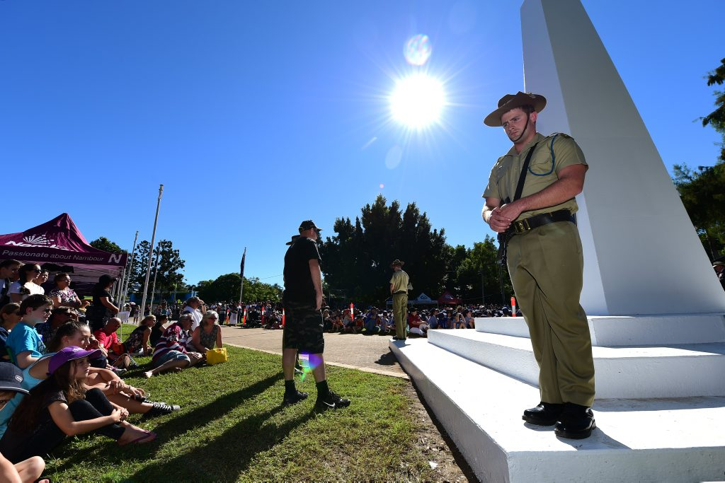 Paying respects during Anzac Day commemorations at Nambour. Photo: Iain Curry / Sunshine Coast Daily