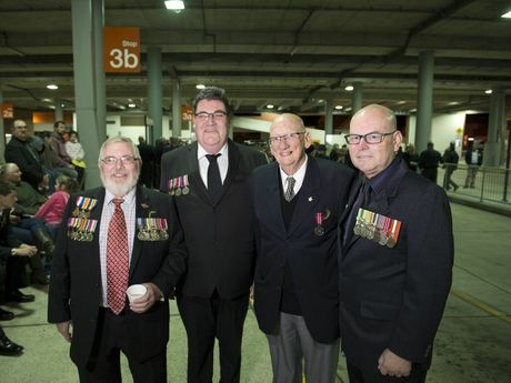 Ex-service personnel (from left) Bill Mason, Colin Hartshorn -Smith, Ian Collett and David Hartshorn gather at bus interchange before the march to Anzac Day dawn service.